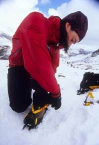 Fitting a crampon c.Alex Messenger